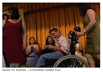 Boy in wheelchair on stage